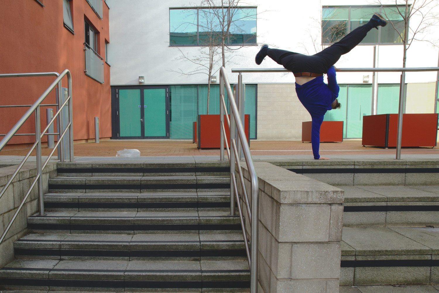 Ian Dolan, man contemporary dancing in the street on steps