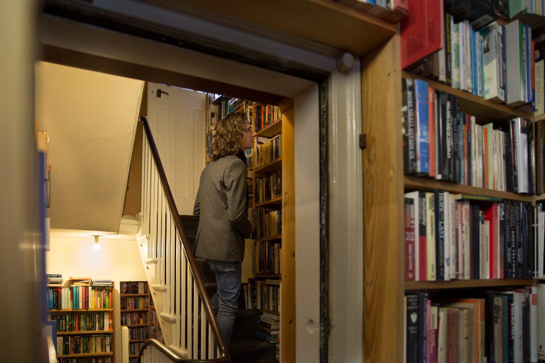 colour book shop man long hair books performance art live art