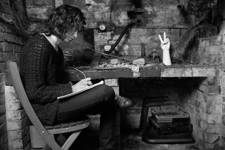 B&W Black and white cellar man long hair books performance art live art