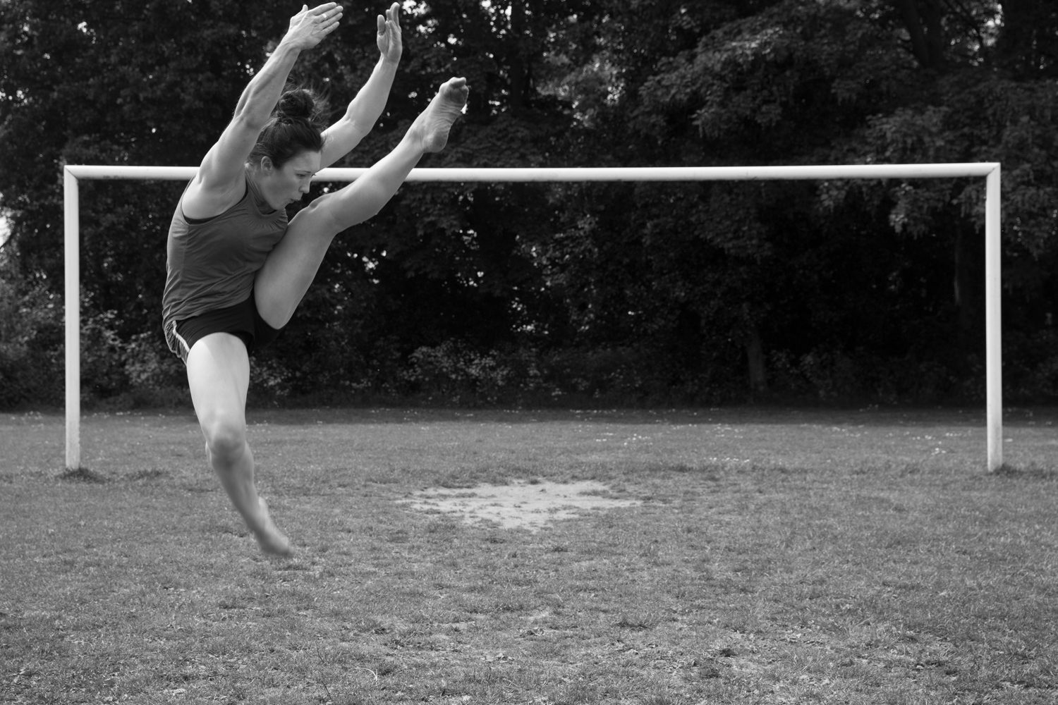 Dance Contemporary dance park sports ground goal posts b&w black and white