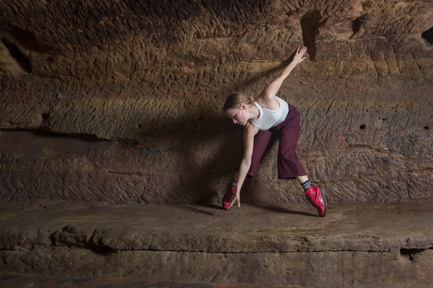 Amy Harris dancing in the caves of the Maltcross in Nottingham