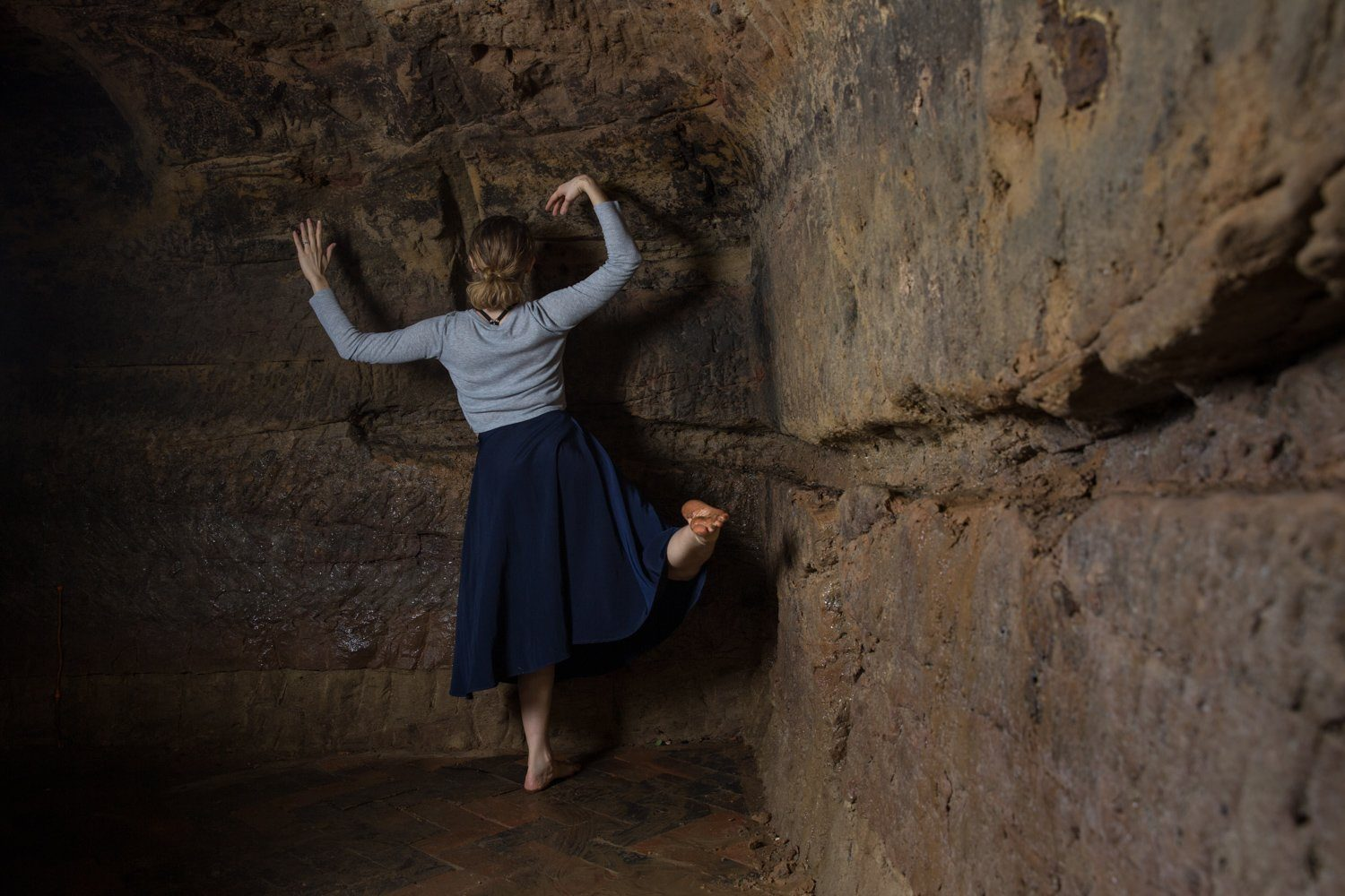 Amy Harris being silly while dancing in the caves of the Maltcross in Nottingham