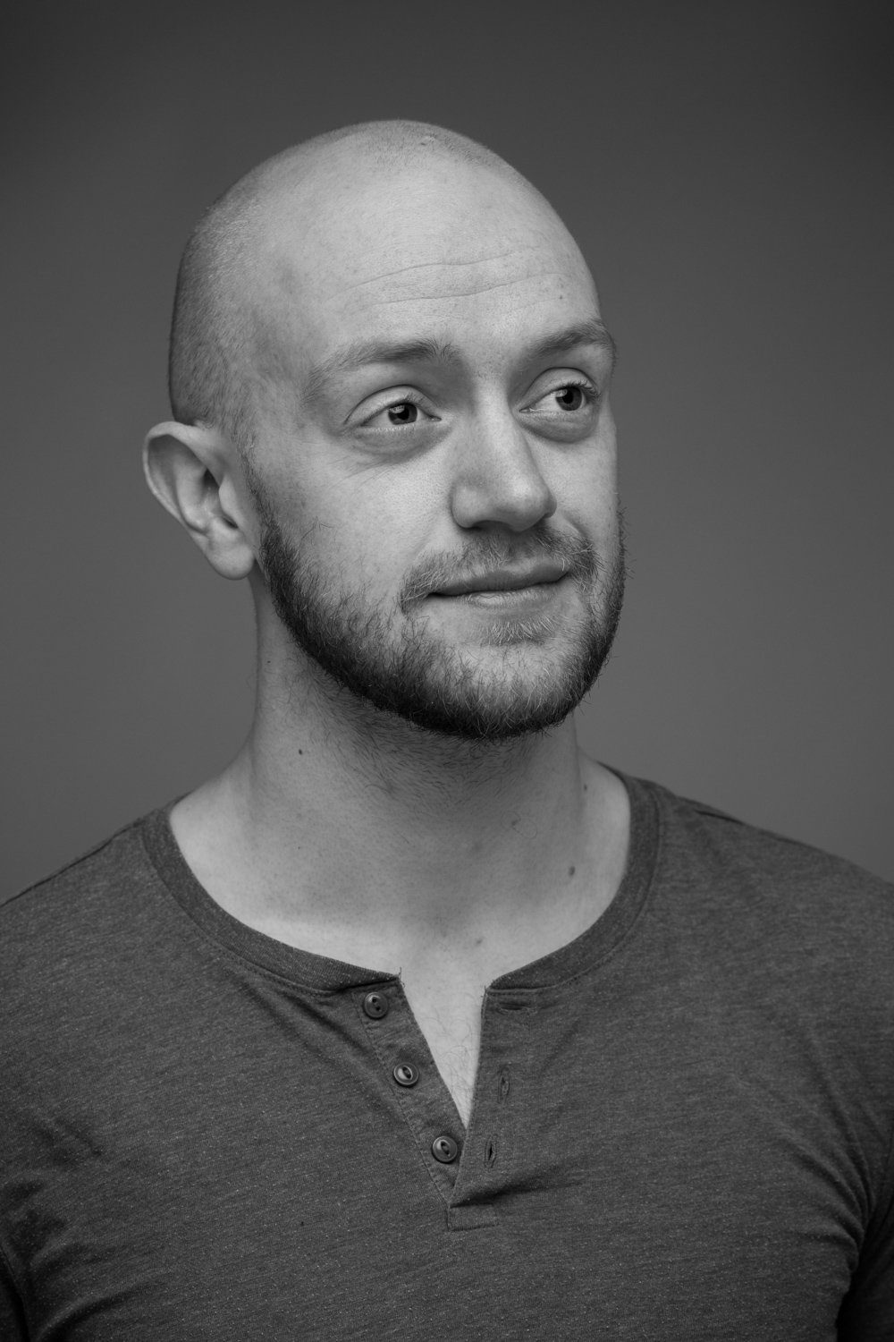 Black and white headshot of actor Jonny McClean in Leicester studio