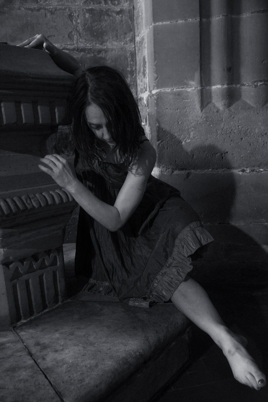 Black & white photo of Giada dancing behind a font