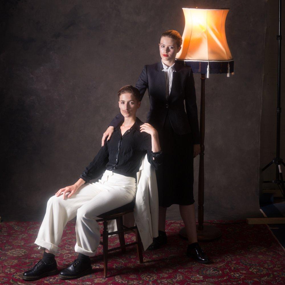 Danni Spooner standing & Carise ZM sitting portrait with lamp