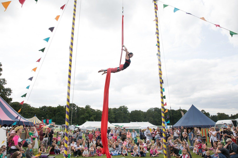 Hannah Burrows on silks at Gloworm Festival