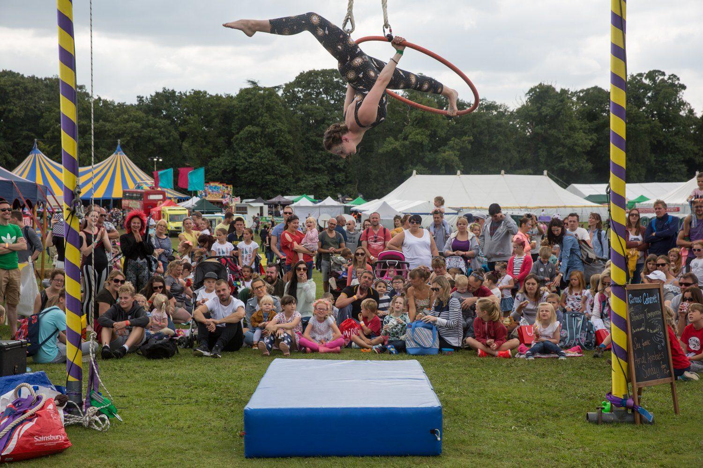 Rosalia Pilsworth on the aerial hoop at Gloworm Festival