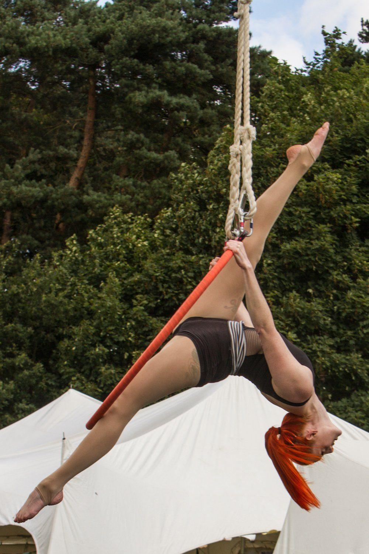 Sara McKenzie on the aerial hoop at Gloworm Festival