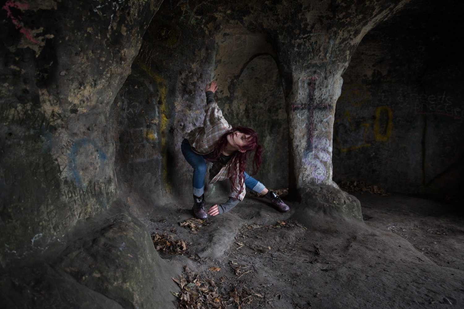 Laura dancing in a cave in Derbyshire