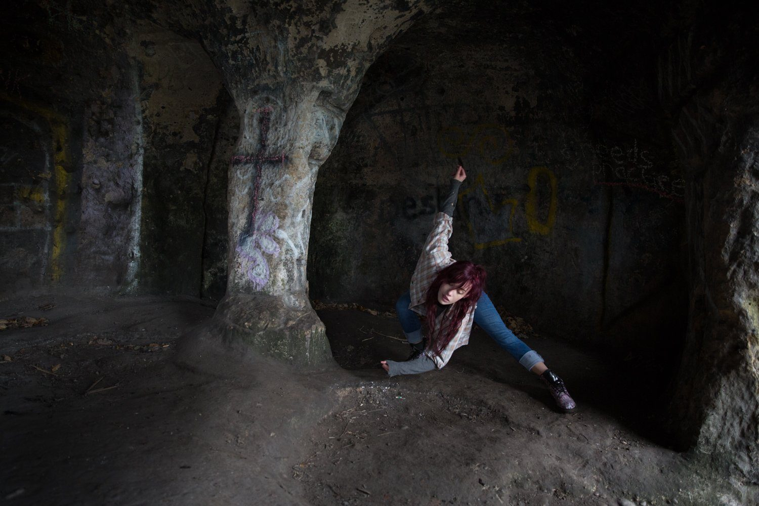 Dancing Laura twisting her body in the cave